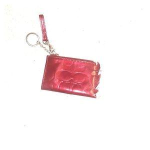 Coach burgundy patent leather wristlet/ keychain.
